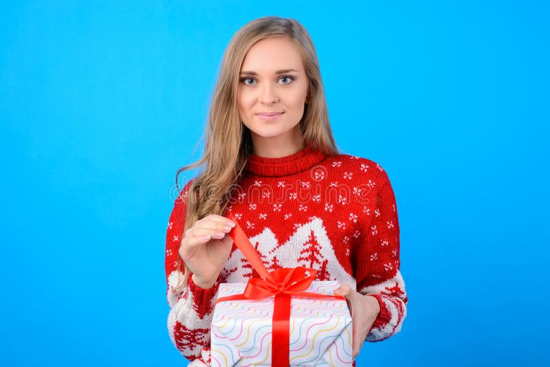 Warm wishes! Happy holidays! Cute young teenag girl is opening b stock photos