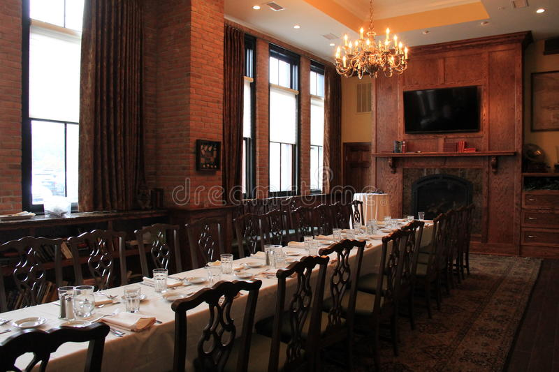 Warm wood and brick room with long table,welcomes patrons in for a visit,Harvey's Restaurant and Bar,Saratoga,New York,2015. Gorgeous craftsmanship in warm wood royalty free stock images