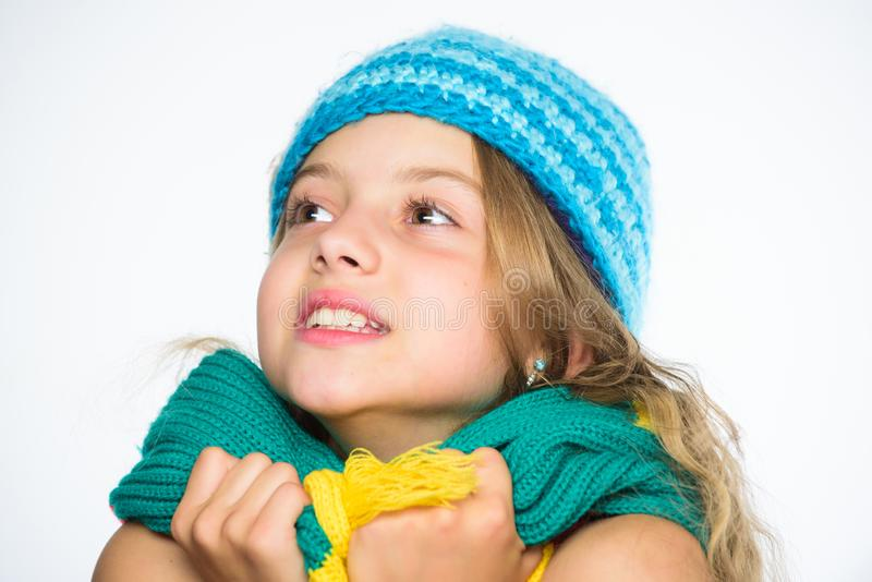 Warm woolen accessories. Hat and scarf keep warm. Which fabrics will keep you warmest this winter. Girl long hair happy. Face white background. Kid wear warm stock images
