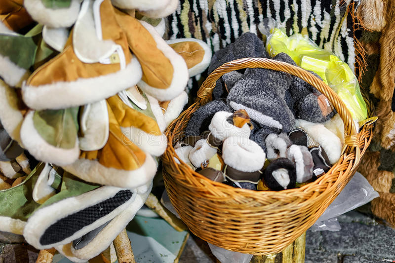 Warm woolen slippers displayed for sale at Riga Christmas market royalty free stock photography