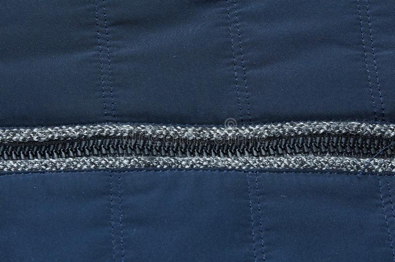 Warme blaue dunkle Reißverschlussjackengewebebeschaffenheits-Hintergrundnahaufnahme stockbilder
