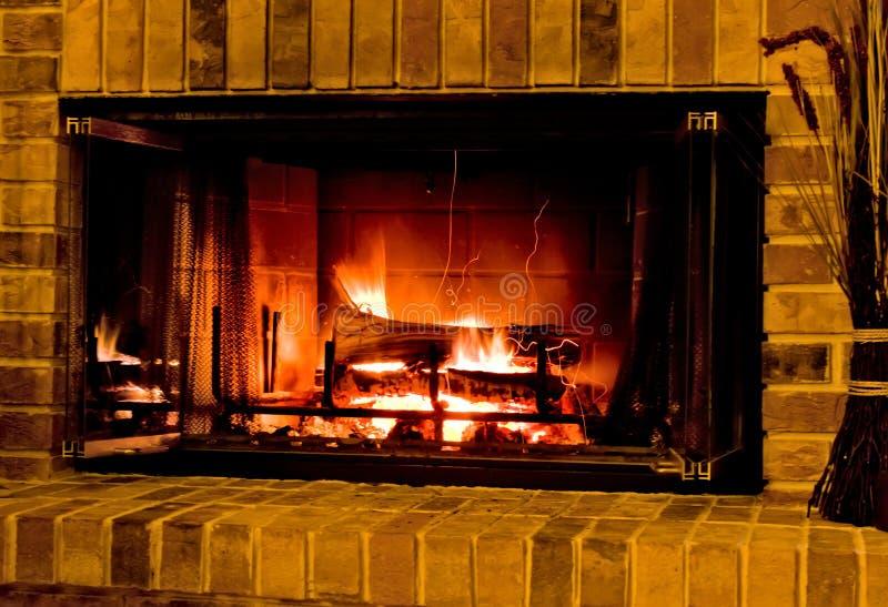 Warme Brandende Open haard stock afbeeldingen