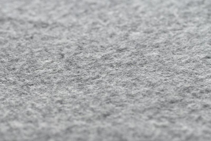 Warme en comfortabele grijze wol algemene textuur, wolstof in grijs close-up stock foto's