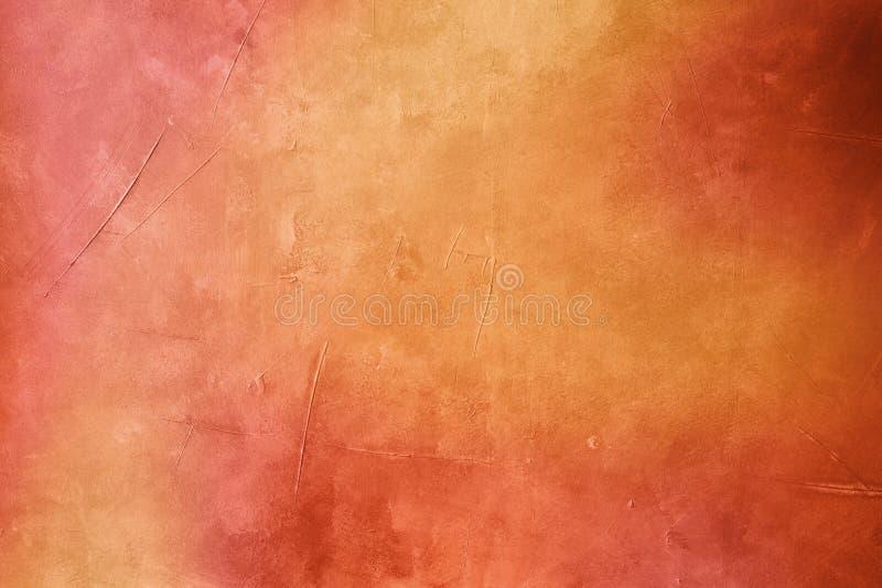 Warme gekleurde grungy achtergrond of textuur stock fotografie