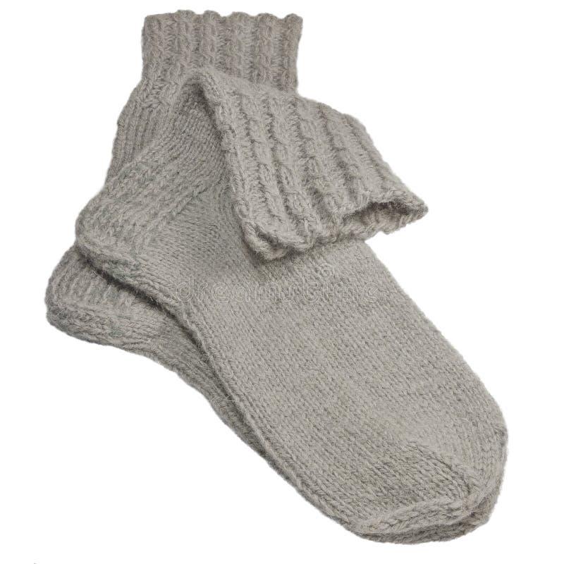Warme grijze gebreide wollen sokken, grote gedetailleerde geïsoleerde macroclose-up, grijs wolmelange paardetail stock afbeeldingen