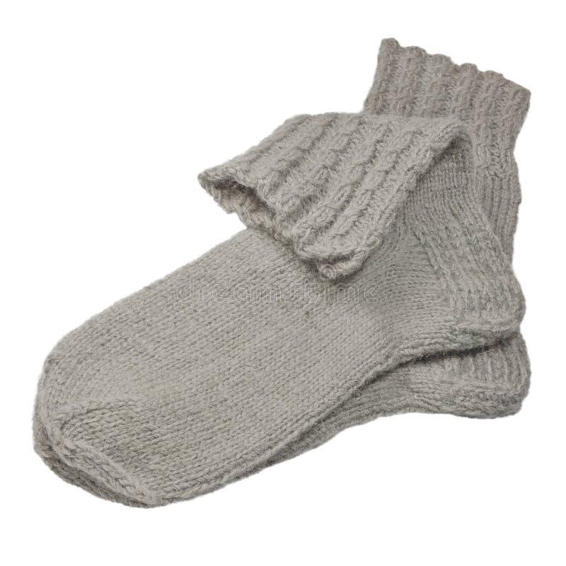 Warme grijze gebreide wollen sokken, grote gedetailleerde geïsoleerde macroclose-up, grijs wolmelange paardetail royalty-vrije stock afbeelding