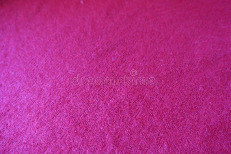 Warmes flaumiges rotes handgemachtes einfaches stockinet Gewebe stockbild