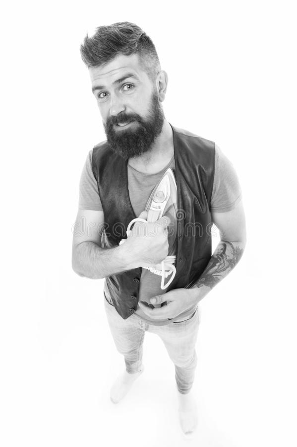 Warming his heart. Man bearded hipster hold electric ironing tool. How iron clothes correctly. Be careful. Guy with iron. On white background isolated. Tailor stock photos