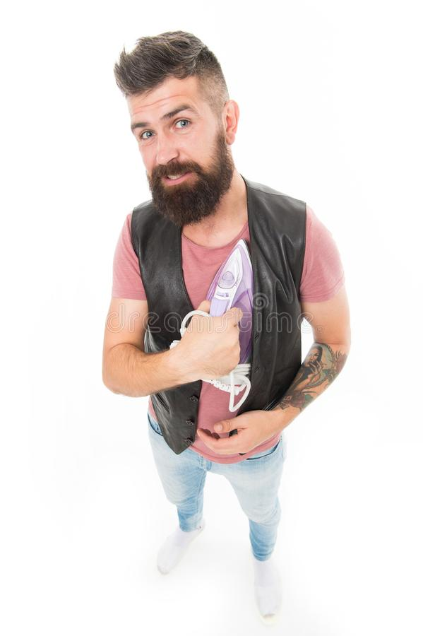 Warming his heart. Man bearded hipster hold electric ironing tool. How iron clothes correctly. Be careful. Guy with iron. On white background isolated. Tailor royalty free stock photos
