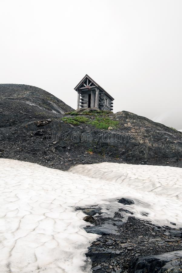 A warming hut in the Alaska mountains. A Warming hut on Exit Glacier hike in Alaska stock photo