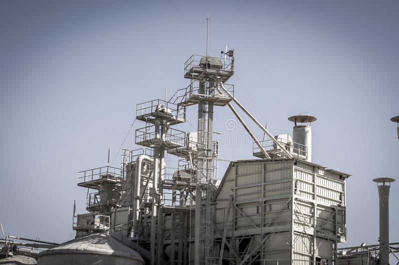 Warming refinery, pipelines and towers, heavy industry overview