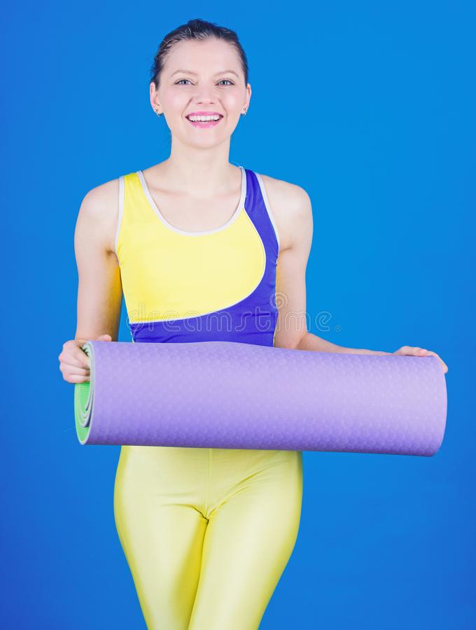 Warming up before training. Sporty woman warming up in gym. Happy woman warming up with fitness mat. Strong muscles and royalty free stock image