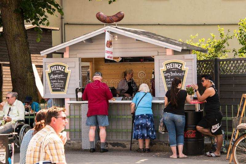 Food stand serving German bratwurst royalty free stock images