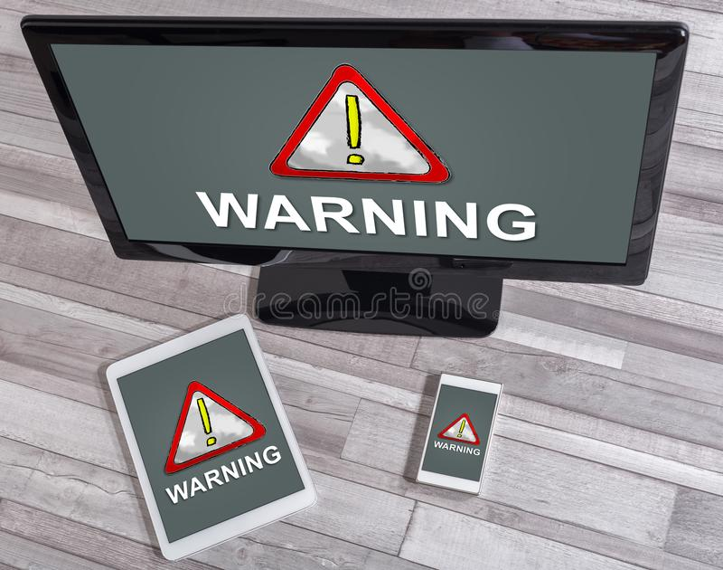 Warning concept on different devices. Warning concept shown on different information technology devices royalty free stock photography