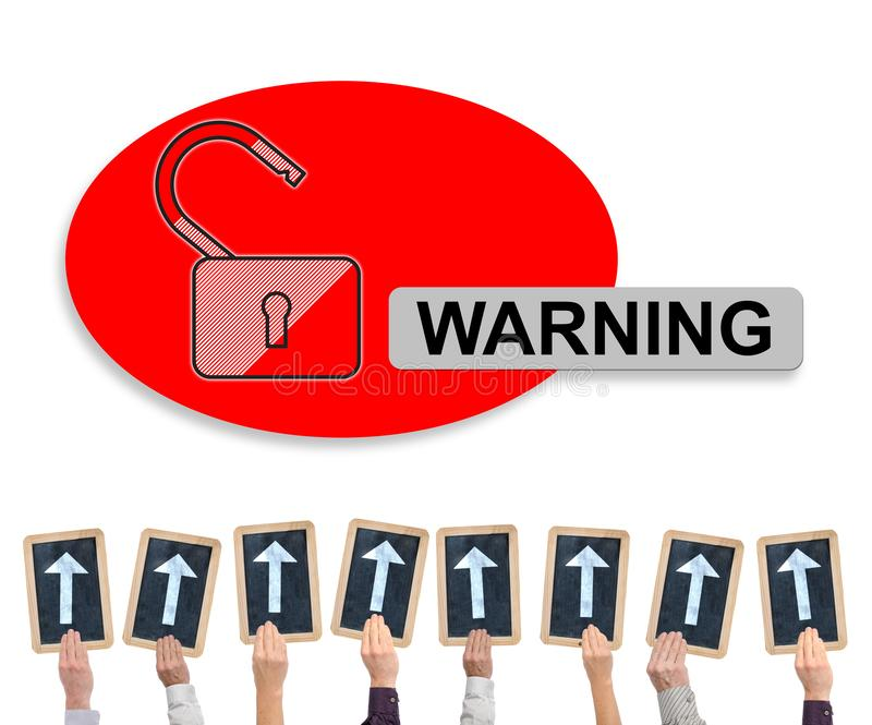Warning concept on a whiteboard. Hands holding writing slates with arrows pointing on warning concept royalty free stock images