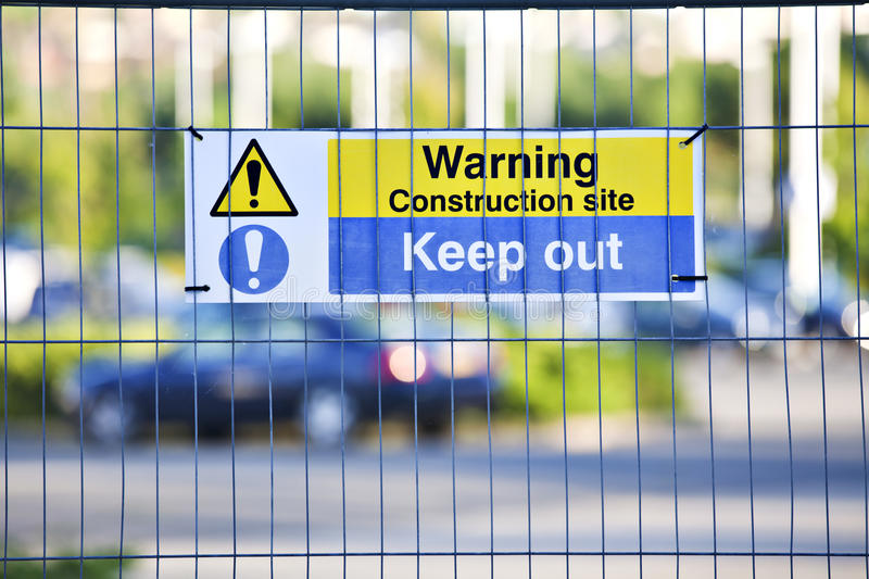 Warning construction area sign on site fence. Warning, construction site. Keep Out sign on site fence royalty free stock photo