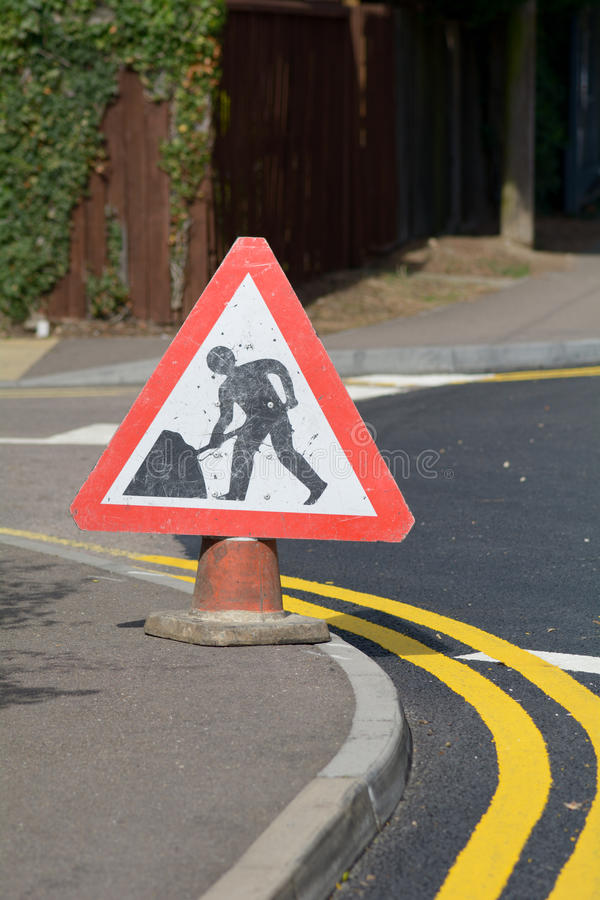 Warning digging ahead road traffic sign. On pavement stock photos