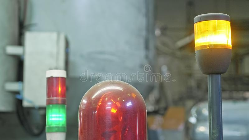 Warning light on processing machine. Closeup flashing red lamp on machine in toilet paper production plant large stock images