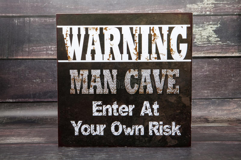 Warning Man Cave stock images
