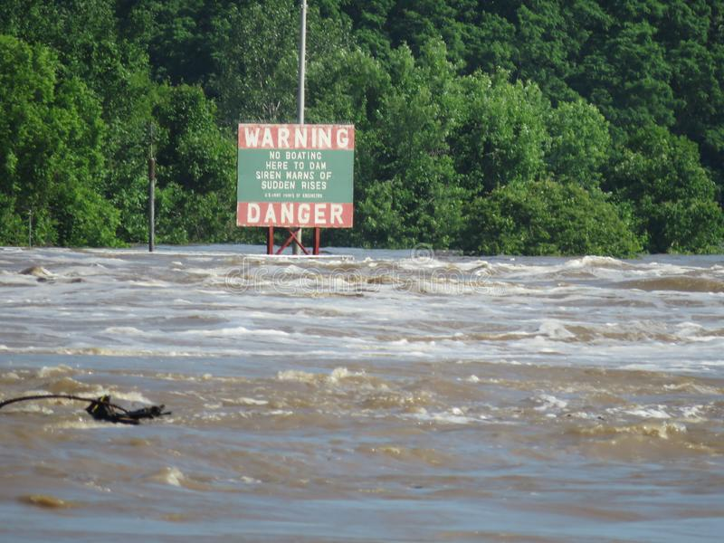 Warning, Danger sign near dam on the Arkansas River. Warning, No Boating Here to Dam, Siren Warns of Sudden Rises, US Army Corps of Engineers. Sign near the stock photography