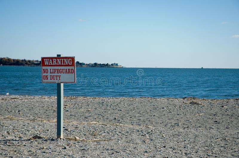 Warning, No Lifeguard On Duty Sign at the Beach stock images