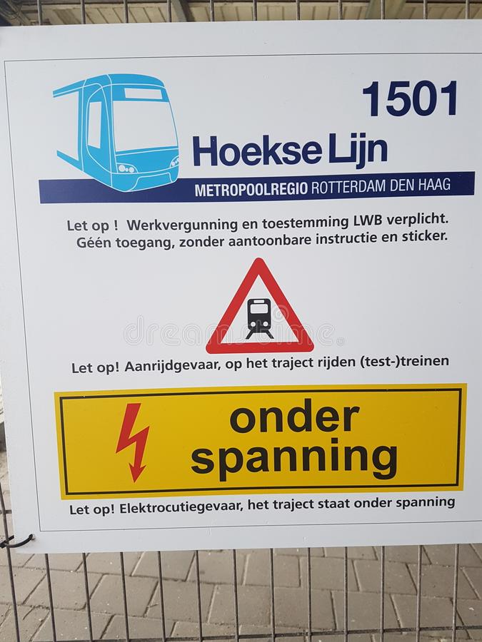 Warning panel on station Hoek van Holland where reconstruction of train to metro is going on but took lot more time and money stock photography
