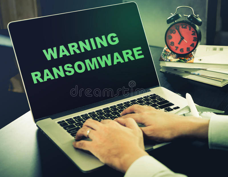 Warning for Ransomware on a computer. Warning for Ransomware on an office computer stock images