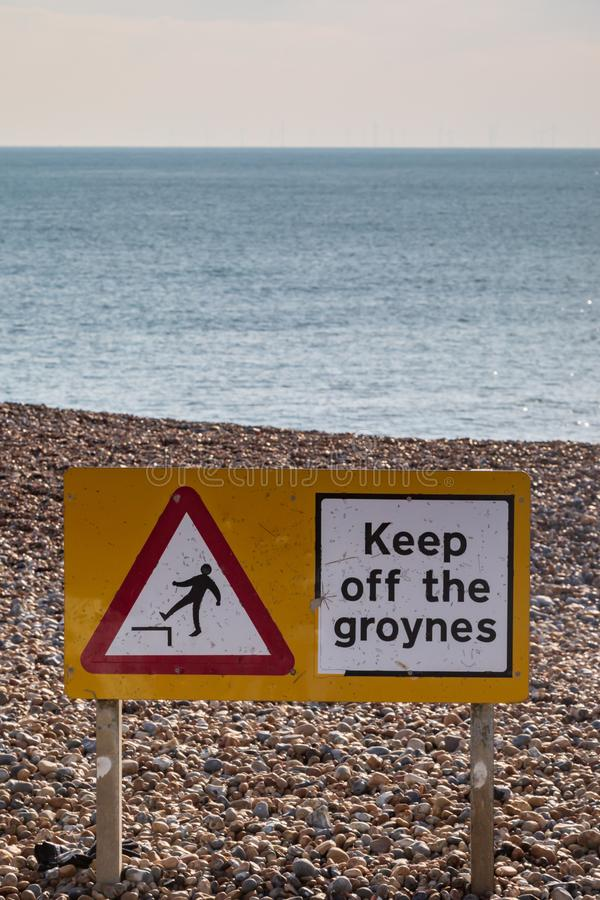A Warning Sign at the Beach. In Brighton, on a sunny winters day stock photography