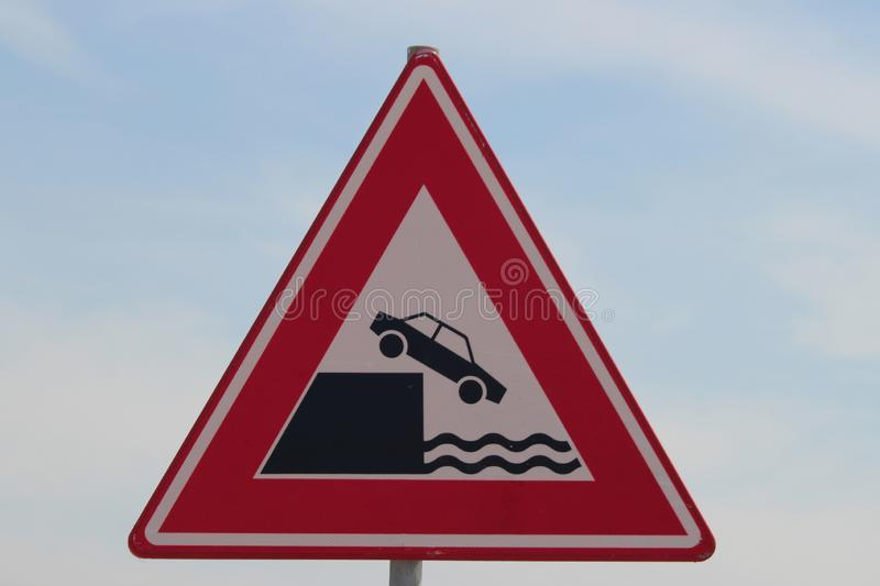 Warning sign that car can be falling of the quay in the harbor of Rotterdam. stock photos