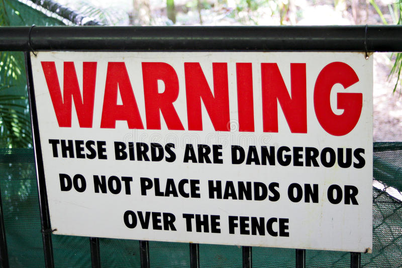 Zoo warning sign on fence for dangerous large birds. stock images