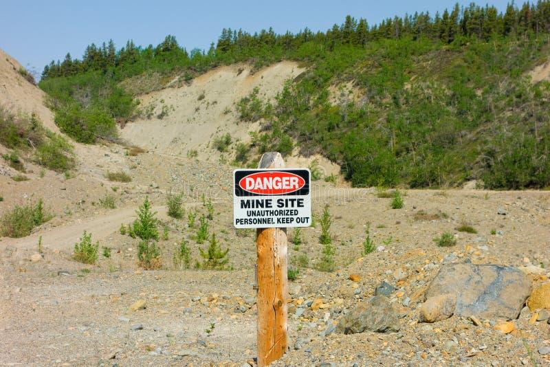 A warning sign indicating active mining at otter creek, bc royalty free stock photos
