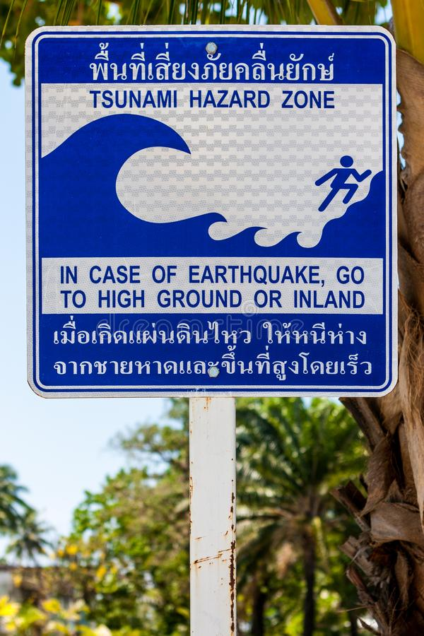 Sign indicating the evacuation route in case of a tsunami. Phi Phi Island, Thailand. stock photography