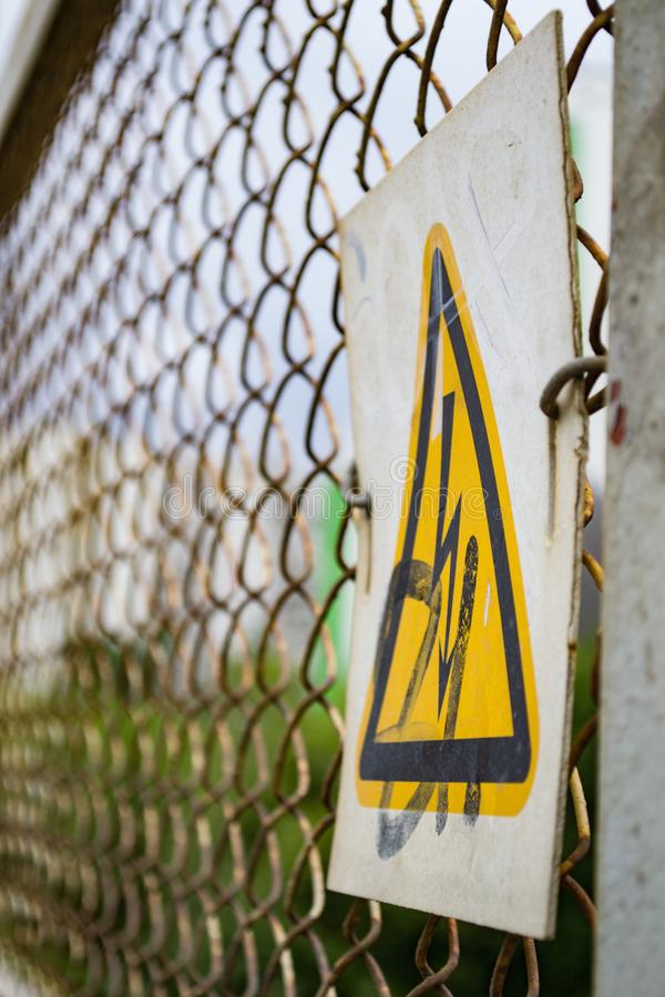 Warning sign on an iron fence stock photos
