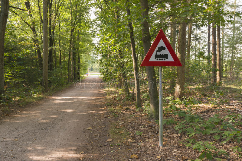 Warning sign with meaning level crossing without barriers in the royalty free stock image