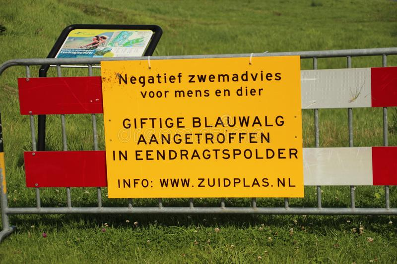 Warning sign of the municipality of Zuidplas to warn for `Blauwalg` or Cyanobacteria in the water of the Eendragtspolder. There royalty free stock image