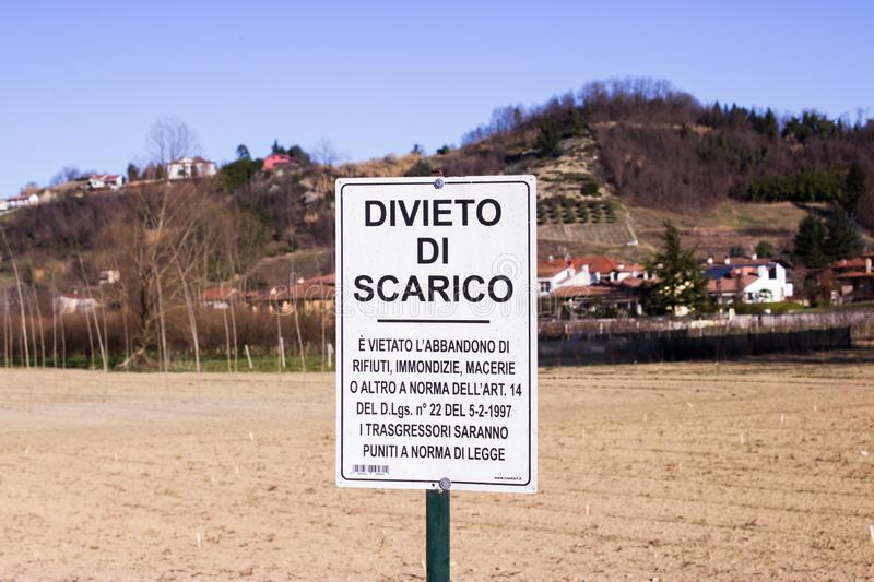 Warning sign prohibiting waste discharge. Corneliano d`Alba, Cuneo / Italy 03-11-2019: Warning sign prohibiting waste discharge royalty free stock images