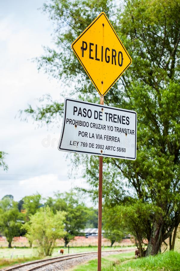 Warning sign in spanish stating do not cross or transit along the train rails. A warning sign in spanish stating do not cross or transit along the train rails stock photos