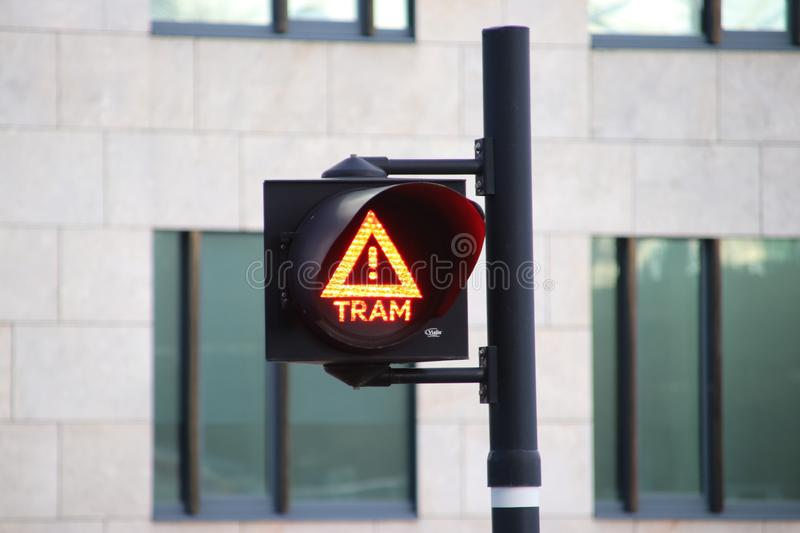 Warning sign on the streets to warn with light and sound for tram is coming. royalty free stock image