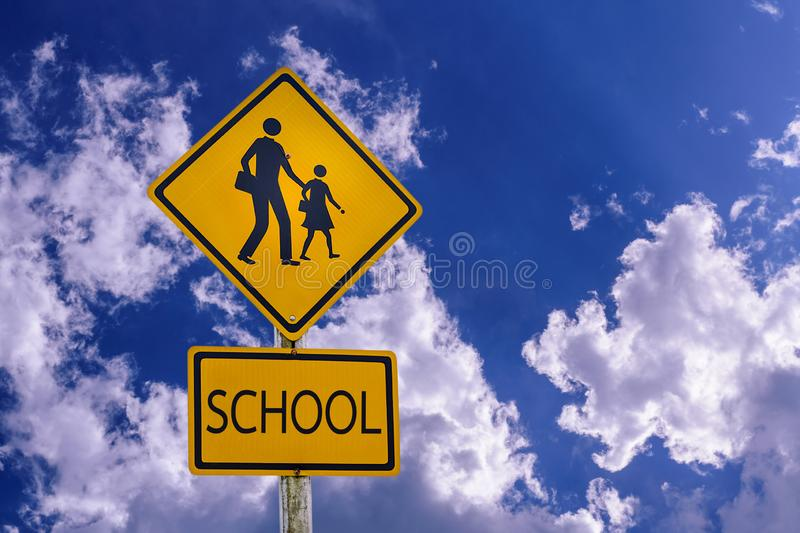 Warning sign for students-kids school crossing the street royalty free stock images