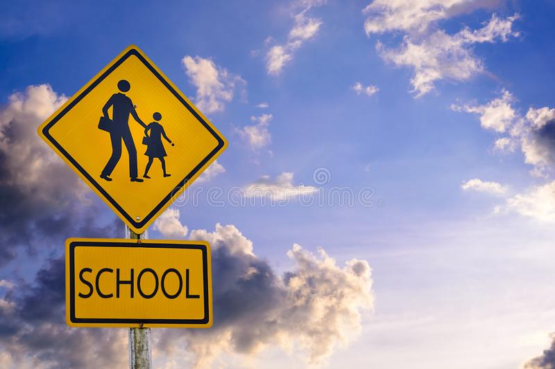 Warning sign for students-kids school crossing the street royalty free stock photos