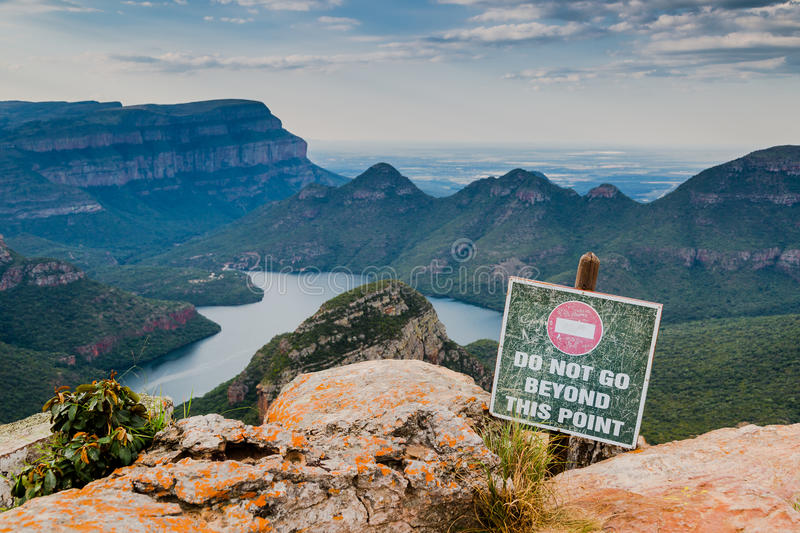 Warning sign. A sign is warning visitors of the Blyde river canyon for the obvious....not to step over the edge stock photo