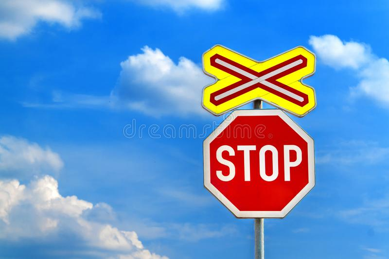 Warning sign worn of level crossing without barriers in Czech Republic, blue sky with clouds. Transport by rail. Danger stock photo