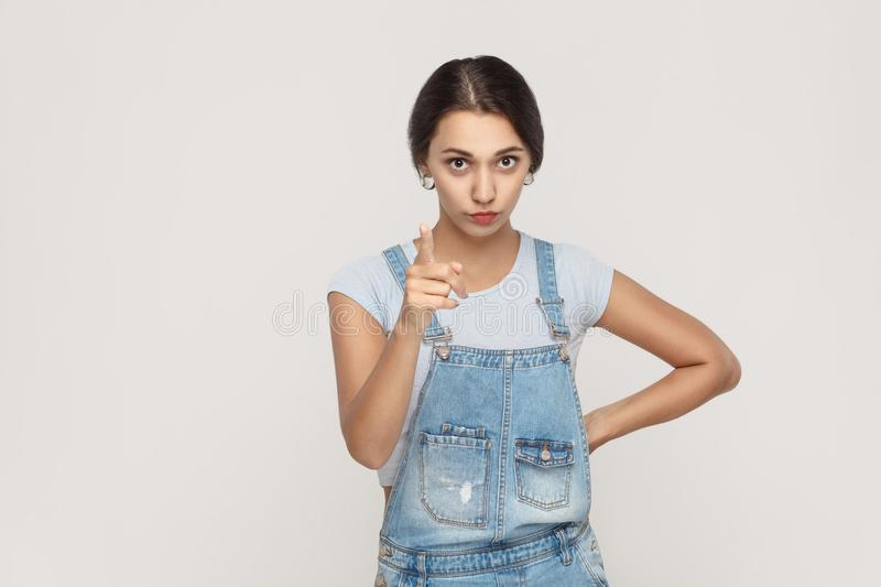 Warning sign. Young adult middle eastern woman, looking at camera with serious face and finger warning. . stock photo