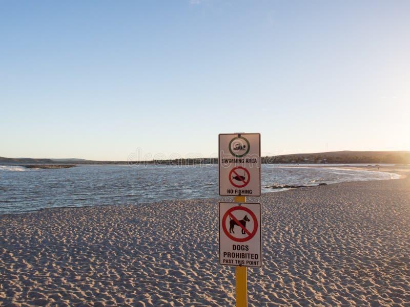 Warning signs on Chinaman`s Beach, Murchison River beach, Kalbarri, Western Australia. stock photo