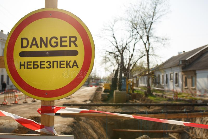 Warning signs about danger and detour. Warning signs about danger on the road, repair work in Ukraine stock photo