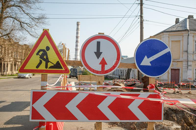Warning signs about danger and detour. Warning signs about detour on the road, repair work in Ukraine royalty free stock images