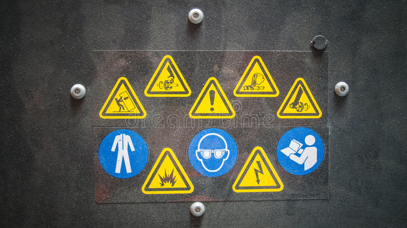 Warning signs in dark. Factory warning signs on black stock image