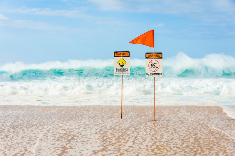No swimming, dangerous shorebreak. Warning signs indicating no swimming allowed due to huge waves and dangerous shorebreak near the Banzai Pipeline on the North royalty free stock photo