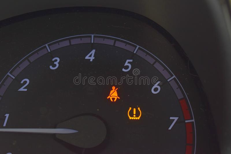 Automobile speedometer seat belt signs stock images