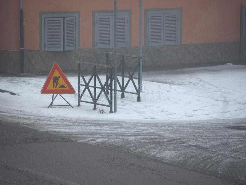 Road works sign in the snow. Warning signs, road works traffic sign in the snow royalty free stock photos